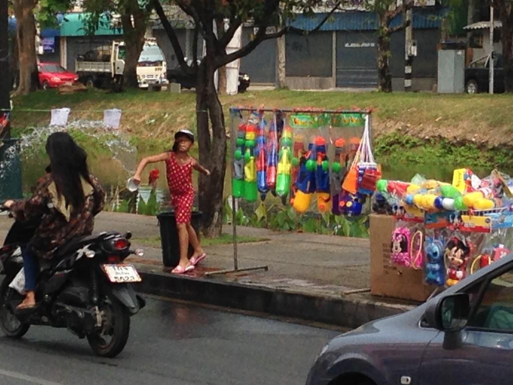 girl throwing water Chiang Mai