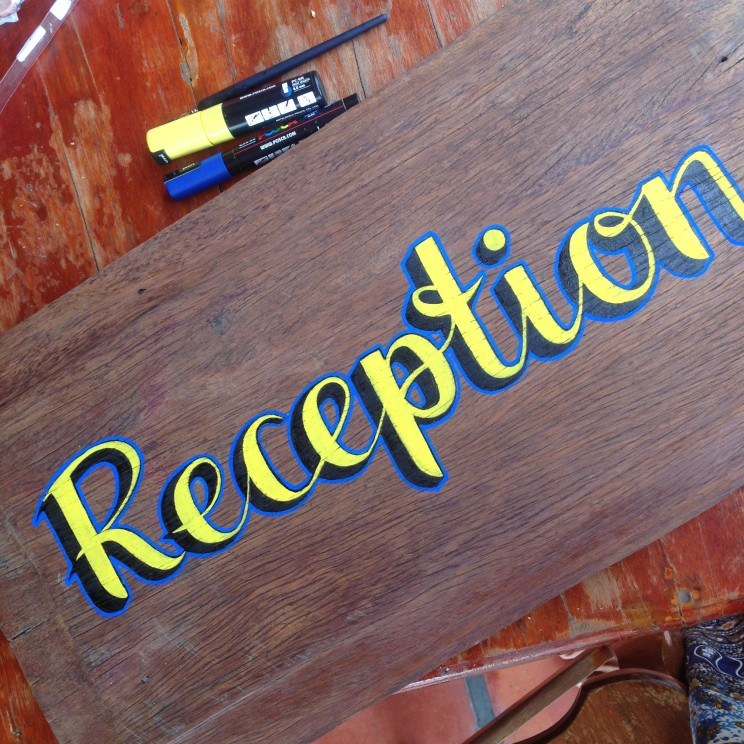 sign painting reception tomato guesthouse battambang cambodia