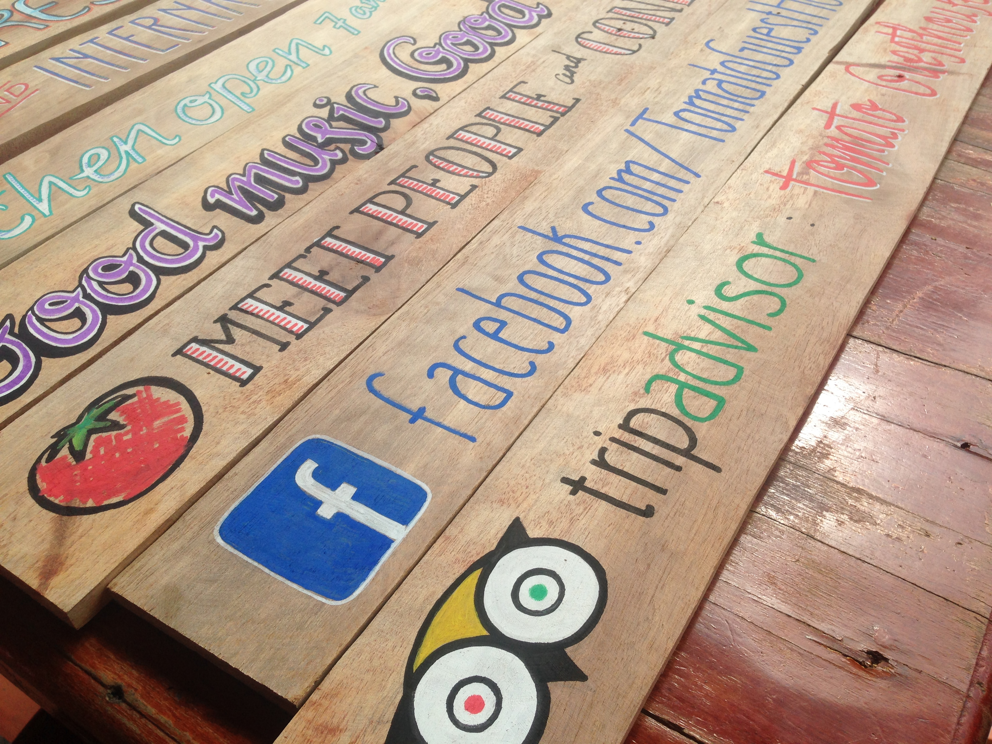 sign painting tomato guesthouse battambang cambodia
