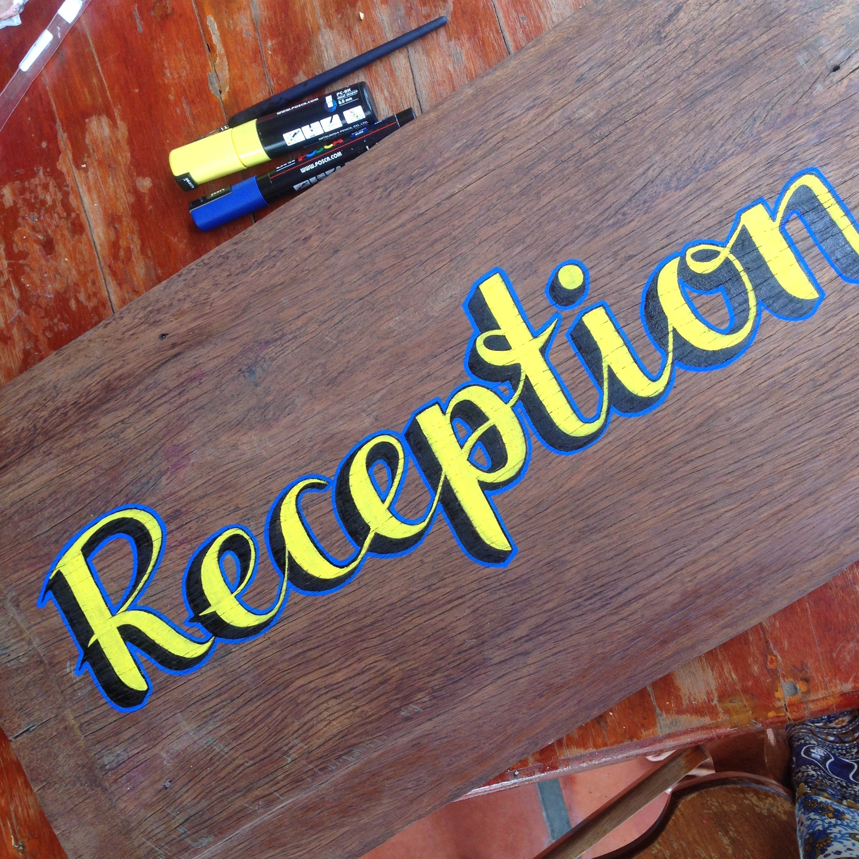 sign painting reception tomato guesthouse battambang cambodia